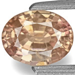 0.79-Carat IGI-Certified Oval Padparadscha Sapphire (Unheated)