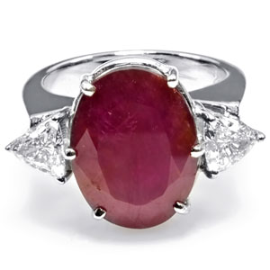 14K Gold Ring mounted with an African Ruby & 2 Trilliant diamonds