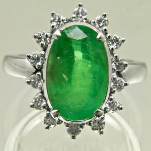 Ring containing a Colombian Emerald surrounded with diamonds